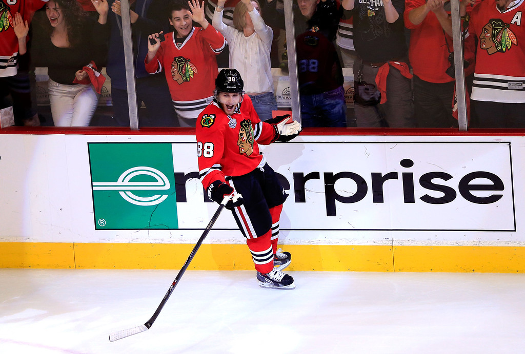 . CHICAGO, IL - JUNE 22:  Patrick Kane #88 of the Chicago Blackhawks celebrates after scoring a goal in the first period against Tuukka Rask #40 of the Boston Bruins in Game Five of the 2013 NHL Stanley Cup Final at United Center on June 22, 2013 in Chicago, Illinois.  (Photo by Jamie Squire/Getty Images)