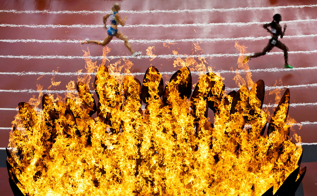. In this Aug. 3, 2012 file photo, runners pass by the Olympics flame on the first day of the athletics in the Olympic Stadium at the 2012 Summer Olympics in London. (AP Photo/Daniel Ochoa De Olza, File)
