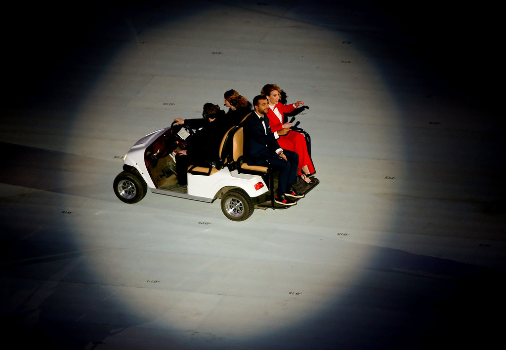 . Pre-show hosts Ivan Urgant (L) and Yana Churikova arrive during the Opening Ceremony of the Sochi 2014 Winter Olympics at Fisht Olympic Stadium on February 7, 2014 in Sochi, Russia.  (Photo by Quinn Rooney/Getty Images)