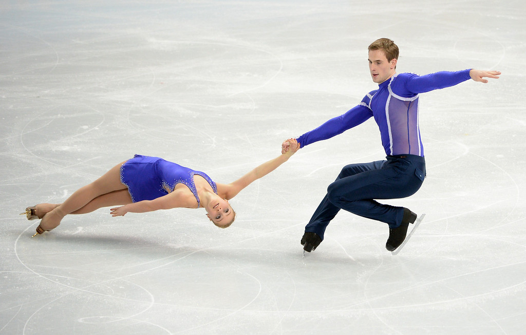 Description of . Ukraine's Julia Lavrentieva and Ukraine's Yuri Rudyk perform in the Figure Skating Pairs Short Program at the Iceberg Skating Palace during the 2014 Sochi Winter Olympics on February 11, 2014.   JEJUNG YEON-JE/AFP/Getty Images