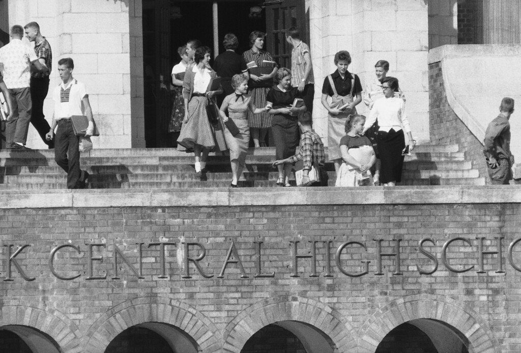 . White students start walk-out at Little Rock Central High School on Oct. 3, 1957. This is the first group of about 75 students who walked out in protest of integration of the school. (AP Photo/FK)