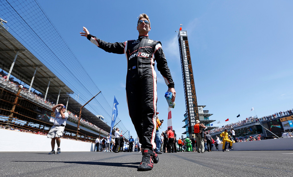 . Will Power, of Australia, waves to fans as he walks to his car before the start of the 98th running of the Indianapolis 500 IndyCar auto race at the Indianapolis Motor Speedway in Indianapolis, Sunday, May 25, 2014. (AP Photo/AJ Mast)