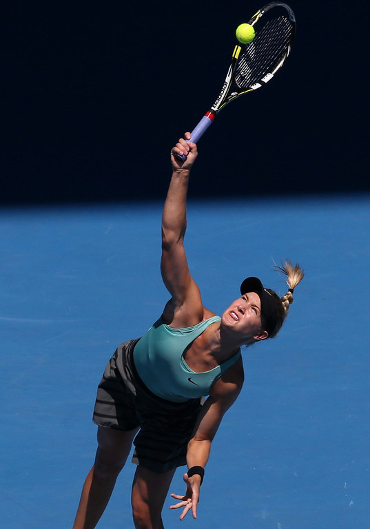 . Eugenie Bouchard of Canada serves to Li Na of China during their semifinal at the Australian Open tennis championship in Melbourne, Australia, Thursday, Jan. 23, 2014.(AP Photo/Eugene Hoshiko)