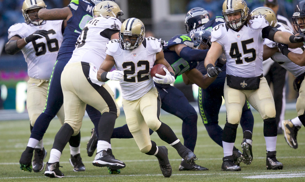. epa04015906 New Orleans Saints running back Mark Ingram rushes the ball during the first half of the NFL Second Round Playoff American football game between the New Orleans Saints and the Seattle Seahawks at CenturyLink Field in Seattle, Washington, USA, 11 January 2014.  EPA/STEPHEN BRASHEAR