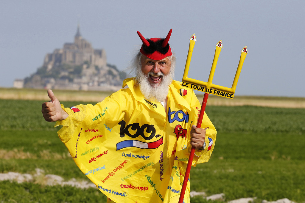 . German fan Didi Senft known as El Diablo poses on July 10, 2013 in front of the Mont-Saint-Michel, before the start of the 33 km individual time-trial and eleventh stage of the 100th edition of the Tour de France cycling race between Avranches and Mont-Saint-Michel, northwestern France.   JOEL SAGET/AFP/Getty Images