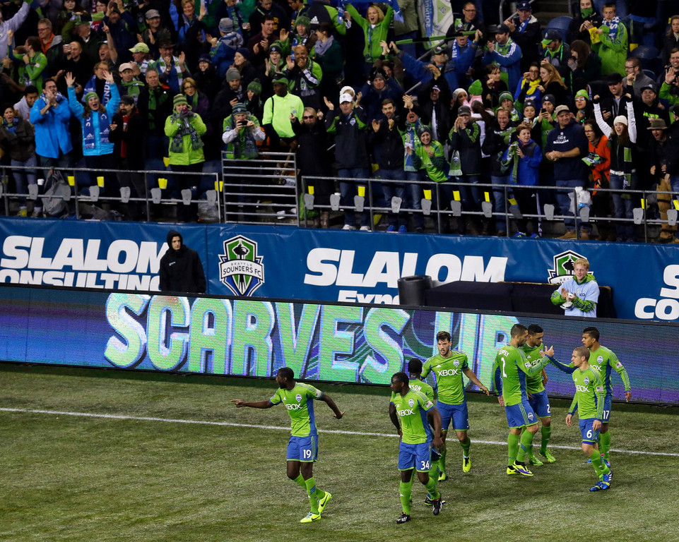 . Seattle Sounders players celebrate after Brad Evans, fourth from left, scored a goal against the Colorado Rapids in the first half of a knockout-round match in the MLS Cup soccer playoffs Wednesday, Oct. 30, 2013, in Seattle. (AP Photo/Ted S. Warren)