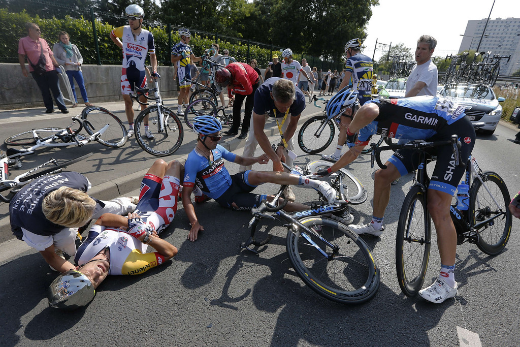 . New Zealand\'s Gregory Henderson (L) lies on the ground after falling during the 218 km twelfth stage of the 100th edition of the Tour de France cycling race on July 11, 2013 between Fougères and Tours, northwestern France.  PASCAL GUYOT/AFP/Getty Images