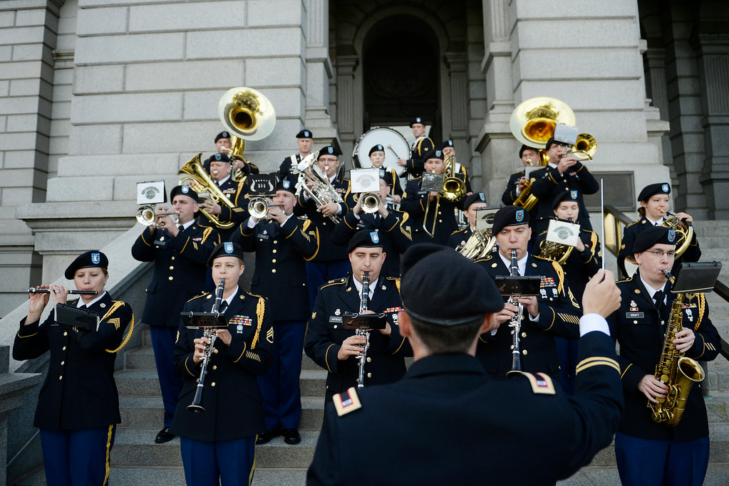 . Colorado Army National Guard Band perform for the crowd during a celebration, for the 138th anniversary of the state of Colorado, on the west steps of Colorado State Capitol in Denver, August 01, 2014. The celebration included dancing, a cake, historical remarks, and more. (Photo by RJ Sangosti/The Denver Post)