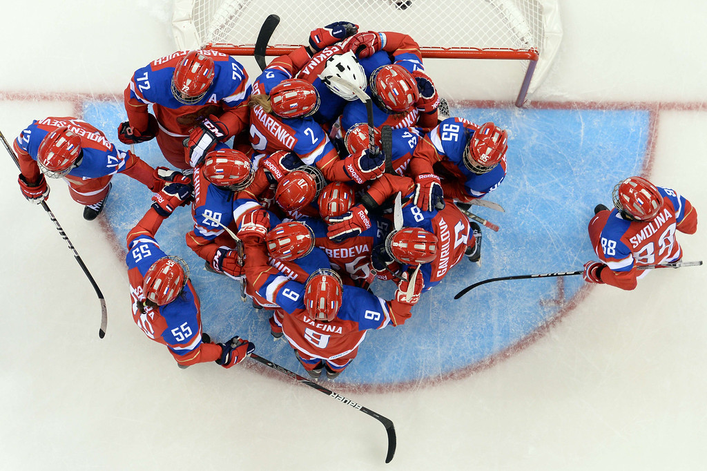 . Russia\'s players celebrate their victory after the Women\'s Ice Hockey Group B match between Russia and Germany at the Shayba Arena during the Sochi Winter Olympics on February 9, 2014.     JONATHAN NACKSTRAND/AFP/Getty Images