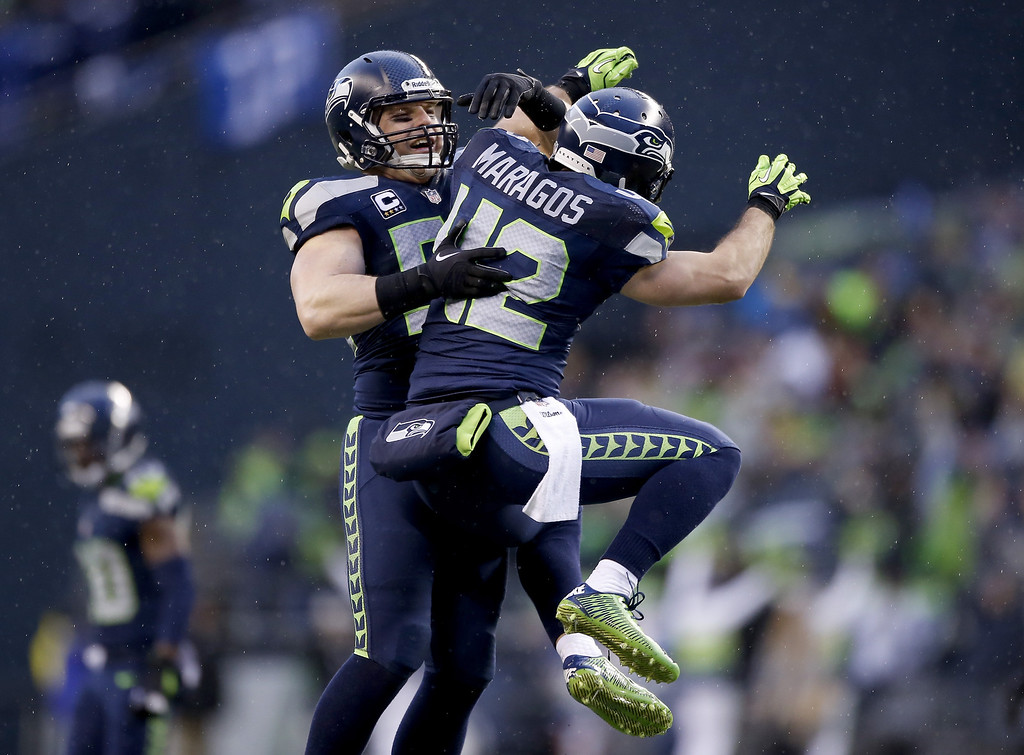 . SEATTLE, WA - JANUARY 11:  Heath Farwell #55 and free safety Chris Maragos #42 of the Seattle Seahawks celebrate in the fourth quarter while taking on the New Orleans Saints during the NFC Divisional Playoff Game at CenturyLink Field on January 11, 2014 in Seattle, Washington.  (Photo by Otto Greule Jr/Getty Images)