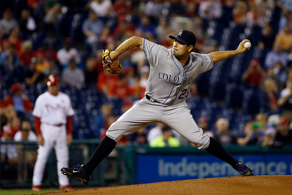 . Colorado Rockies\' Jorge De La Rosa pitches during the first inning of a baseball game against the Philadelphia Phillies, Tuesday, May 27, 2014, in Philadelphia. (AP Photo/Matt Slocum)