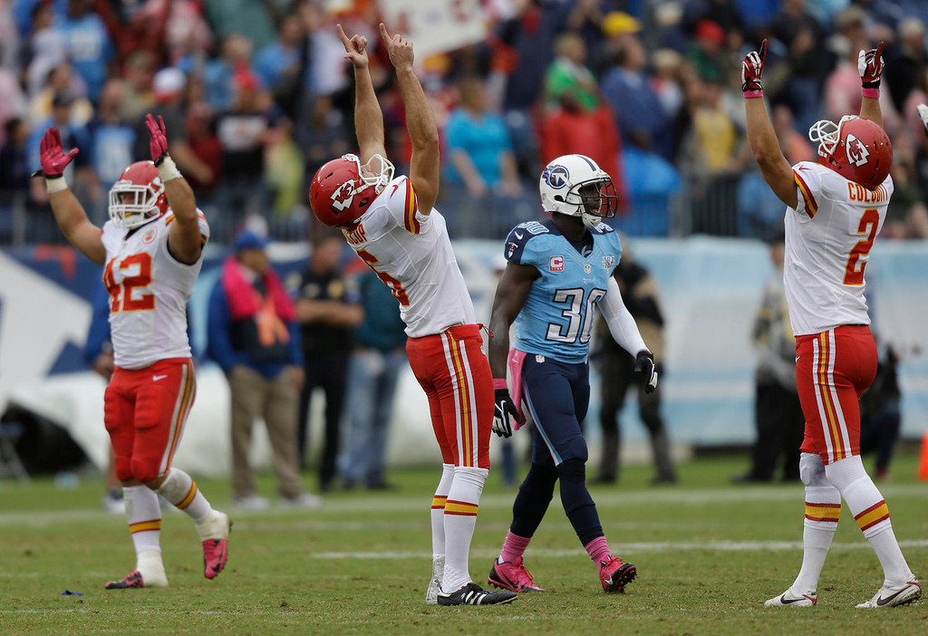 . Tennessee Titans cornerback Jason McCourty (30) walks off the field as Kansas City Chiefs kicker Ryan Succop (6), holder Dustin Colquitt (2), and Anthony Sherman (42) celebrate after Succop kicked a 48-yard field goal to seal the Chiefs\' win over the Tennessee Titans in the final minutes of the fourth quarter of an NFL football game on Sunday, Oct. 6, 2013, in Nashville, Tenn. The Chiefs won 26-17. (AP Photo/Wade Payne)