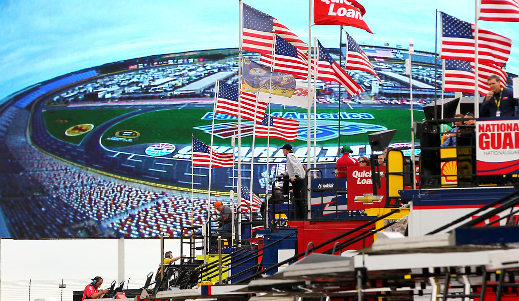 . CONCORD, NC - OCTOBER 11:  Crew members watch as the infield is shown on the the world�s largest video board on the backstretch during practice for the NASCAR Sprint Cup Series Bank of America 500 at Charlotte Motor Speedway on October 11, 2013 in Concord, North Carolina.  (Photo by Jonathan Ferrey/Getty Images)