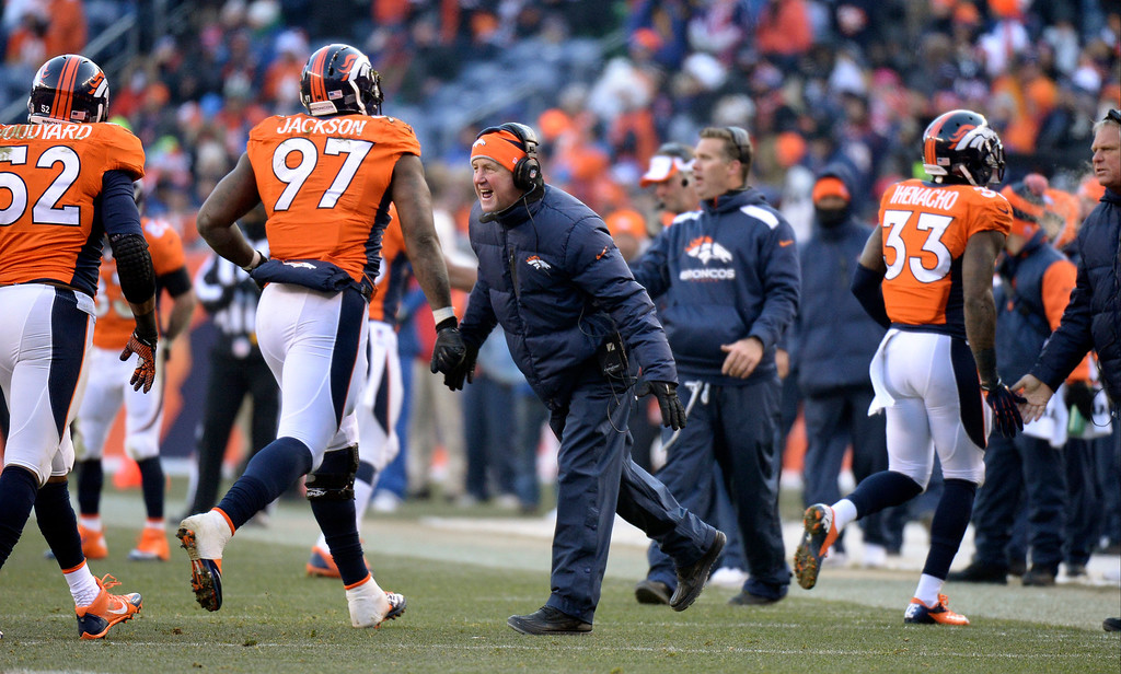 . Denver Broncos head coach John Fox high fives defensive end Malik Jackson (97) as he comes off the field during the first half. (Photo by Hyoung Chang/The Denver Post)