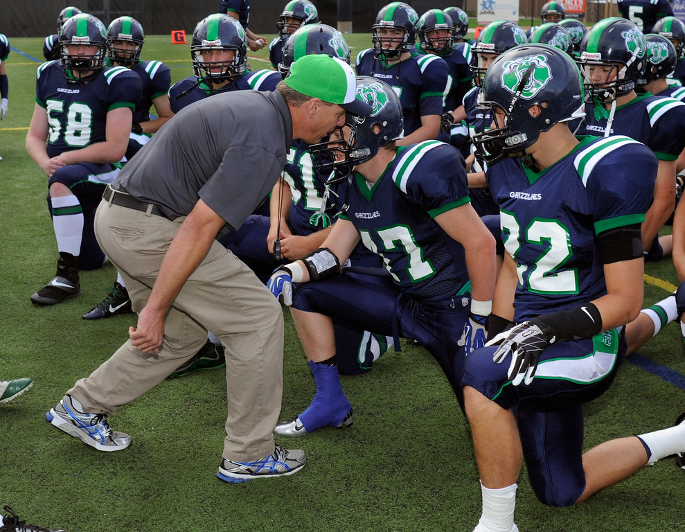. HIGHLANDS RANCH, CO. - SEPTEMBER 13: ThunderRidge coach Joe Johnson shared his thoughts with linebacker Max Lavigne before the game. The ThunderRidge High School football team defeated Grandview 21-7 at Shea Stadium Friday night, September 13, 2013.  Photo By Karl Gehring/The Denver Post