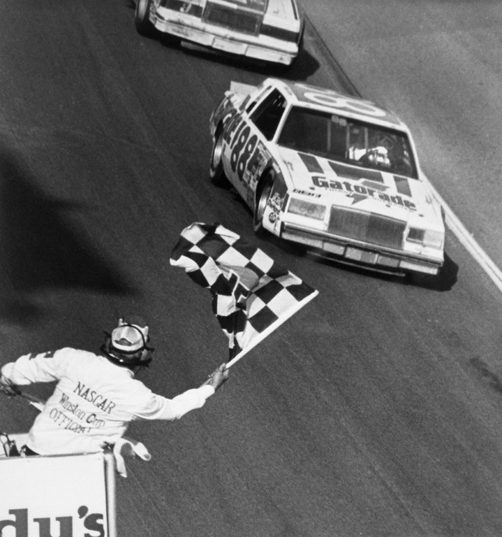 . Original caption: Daytona, Florida: Bobby Allison, Hueytown, Ala., takes the checkered flag to win the 24th Daytona 500. Allison piloted his Buick to victory over a starting field of fourty-two grand national cars. It was the veteran Alabama driver\'s second victory in the 500 miles classic. (Copyright Bettmann/Corbis / AP Images)