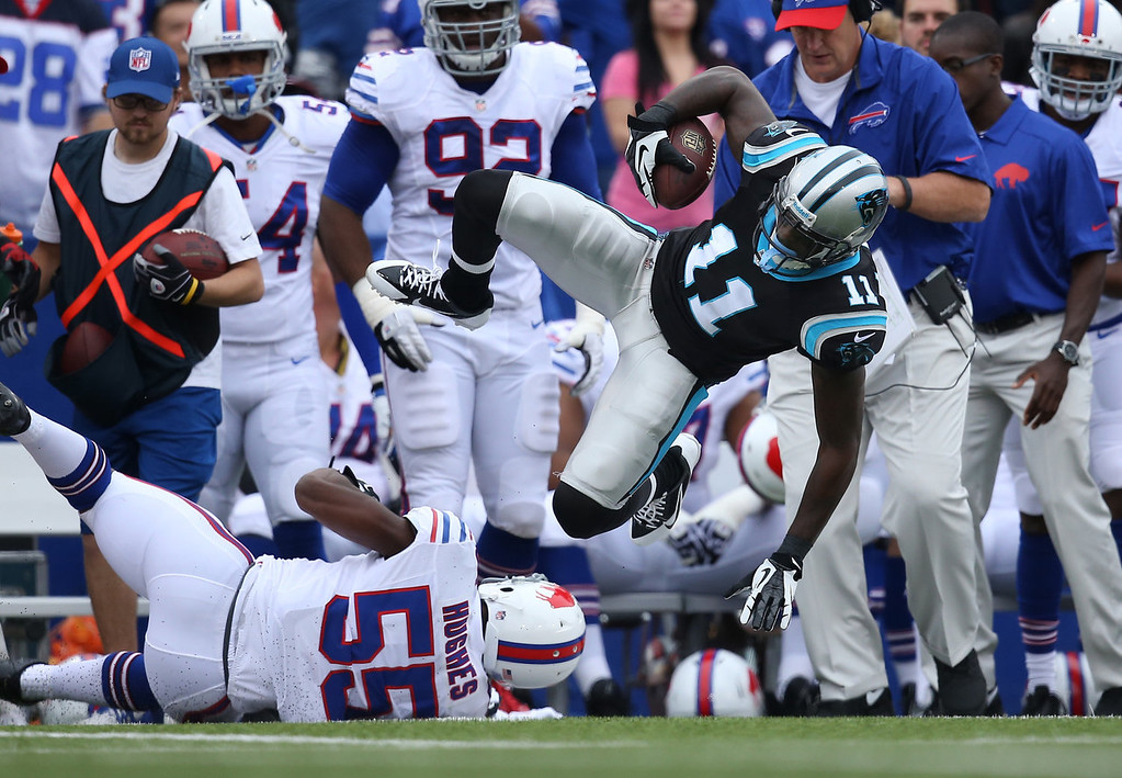 . Brandon LaFell #11 of the Carolina Panthers is tackled after making the catch during NFL game action by Jerry Hughes #55 of the Buffalo Bills at Ralph Wilson Stadium on September 15, 2013 in Orchard Park, New York. (Photo by Tom Szczerbowski/Getty Images)