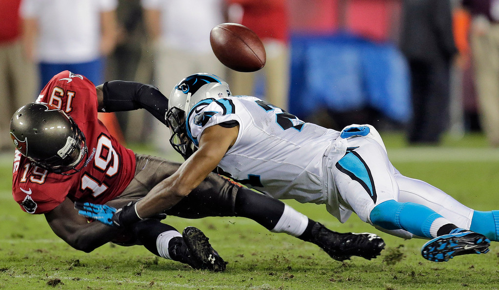 . Tampa Bay Buccaneers wide receiver Mike Williams (19) loses the ball as he is hit by Carolina Panthers free safety Mike Mitchell, right, during the third quarter of an NFL football game on Thursday, Oct. 24, 2013, in Tampa, Fla. (AP Photo/Chris O\'Meara)