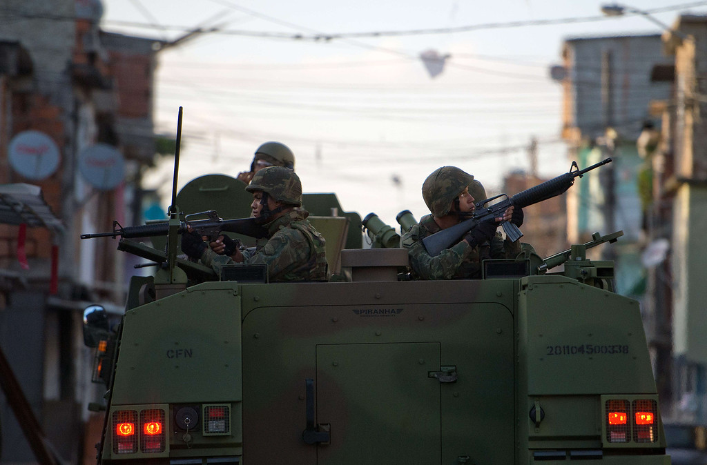 . Brazilian soldiers patrol the street during security operations in Parque Uniao --part of the Mare shantytown complex near the Galeao (Antonio Carlos Jobim) international airport-- in the north suburb of Rio de Janeiro on April 5, 2014. Thousands of soldiers --including some 2,000 paratroopers, 450 sailors and 200 military police-- in armored vehicles, trucks and on foot entered one of Rio de Janeiro\'s most notorious slums to provide security less than three months before the World Cup and until July 30. CHRISTOPHE SIMON/AFP/Getty Images