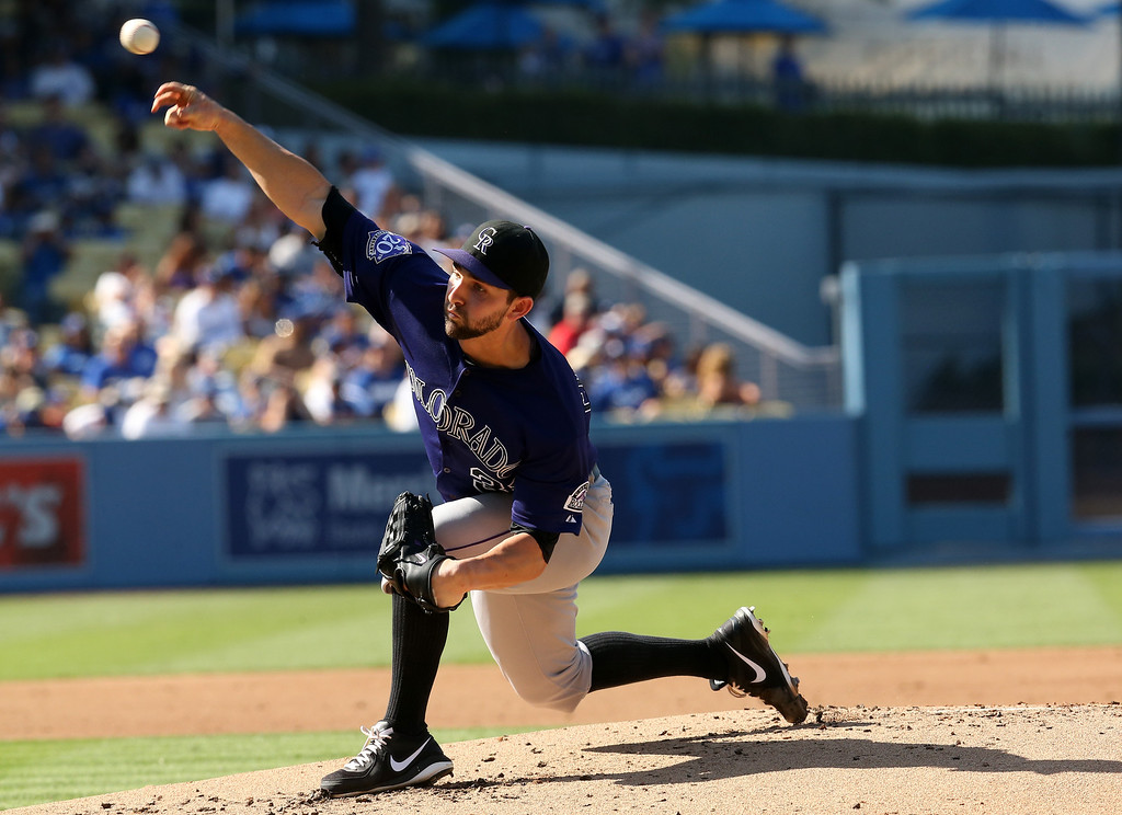 . LOS ANGELES, CA - JULY 13:  Tyler Chatwood #32 of the Colorado Rockies throws a pitch against the Los Angeles Dodgers at Dodger Stadium on July 13, 2013 in Los Angeles, California.  (Photo by Stephen Dunn/Getty Images)