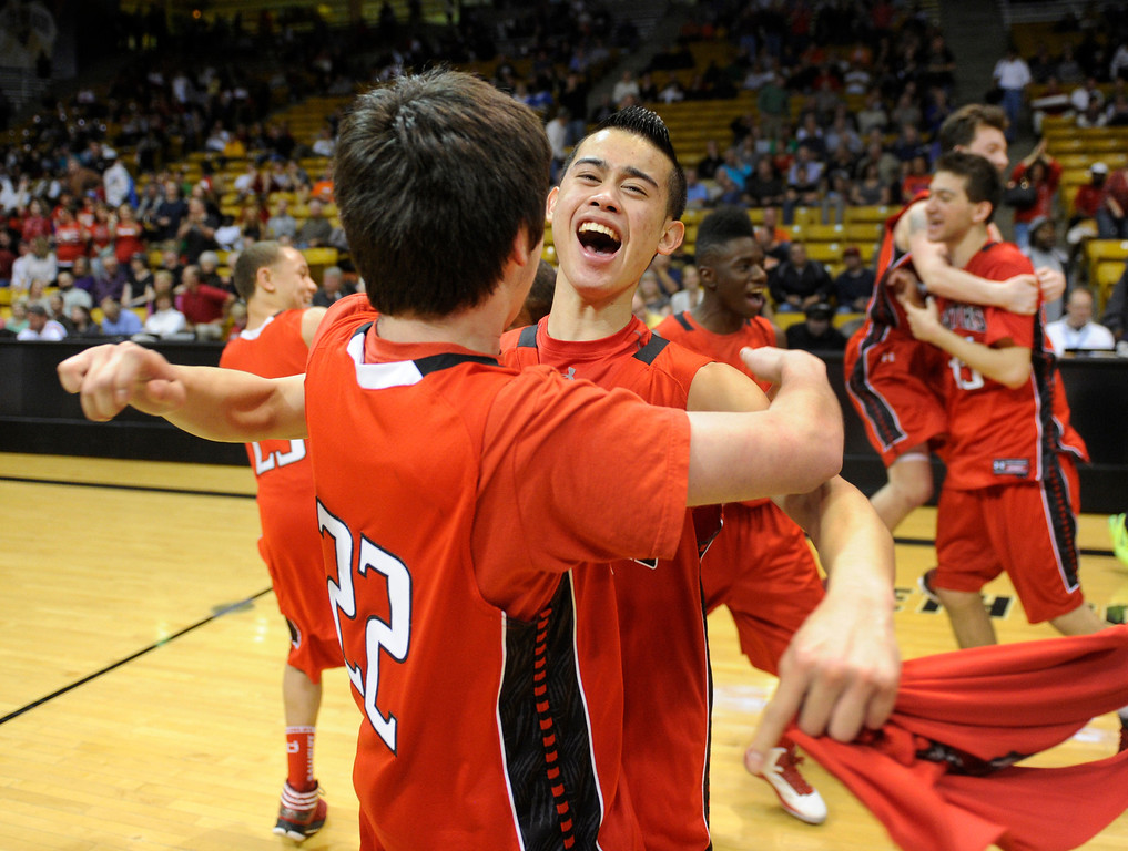 . BOULDER, CO. - MARCH 16: Raptor seniors Maurice Perez (4) and Marcus Carpenter (22) embraced at the buzzer. The Eaglecrest High School boy\'s basketball beat Denver East 63-44 in the 5A championship game Saturday, March 16, 2013 at the Coors Events Center in Boulder.  (Photo By Karl Gehring/The Denver Post)
