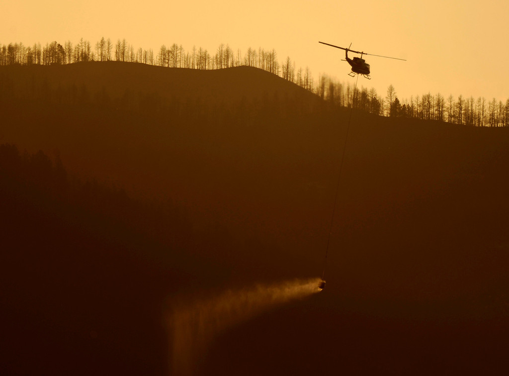. A helicopter ferried a bucket of water pulled from Horsetooth Reservoir to a hotspot burning west of Fort Collins Saturday evening. Larimer County Sheriff\'s officials said Saturday, June 16, 2012 that the number of homes lost in the High Park fire has reached 181.  That would make the fire the most destructive wildfire in Colorado history. Karl Gehring/The Denver Post