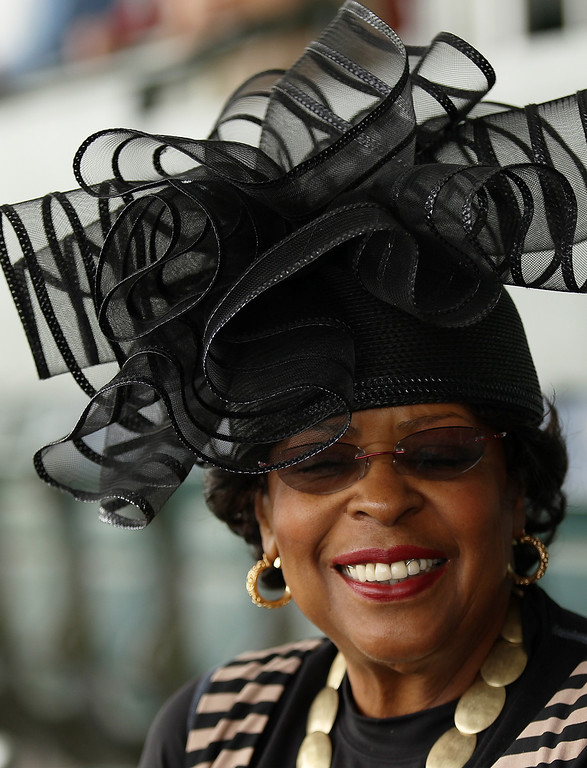 . A woman wearing a hat attends the 145th running of the Belmont Stakes at Belmont Park on June 8, 2013 in Elmont, New York.  (Photo by Mike Stobe/Getty Images)