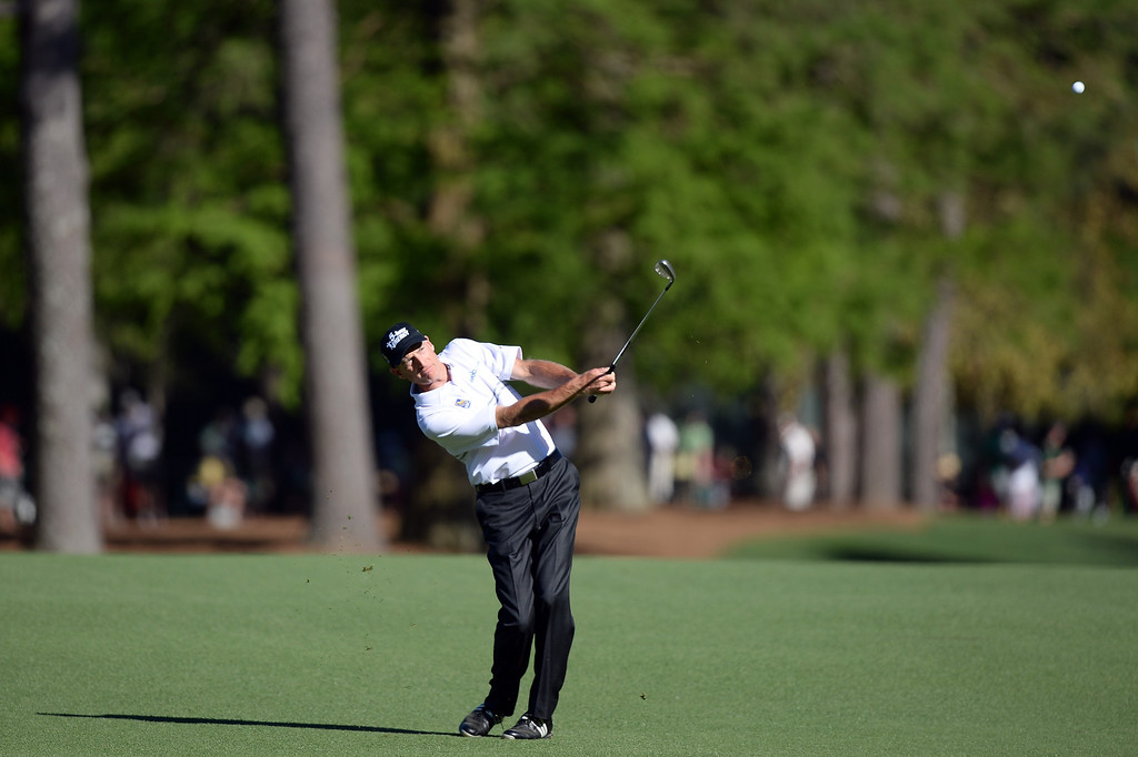 . AUGUSTA, GA - APRIL 13:  Jim Furyk of the United States hits a shot on the 13th hole during the third round of the 2013 Masters Tournament at Augusta National Golf Club on April 13, 2013 in Augusta, Georgia.  (Photo by Harry How/Getty Images)