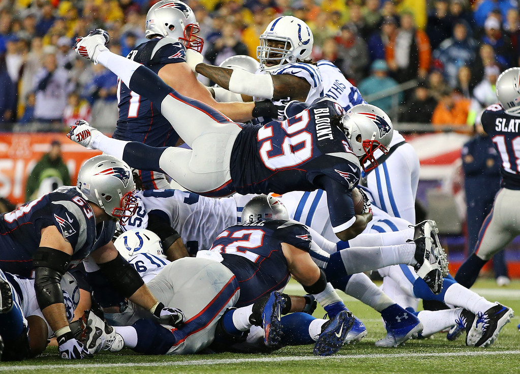 . FOXBORO, MA - JANUARY 11:  LeGarrette Blount #29 of the New England Patriots scores a 2 yard touchdown in the second quarter against the Indianapolis Colts during the AFC Divisional Playoff game at Gillette Stadium on January 11, 2014 in Foxboro, Massachusetts.  (Photo by Al Bello/Getty Images)