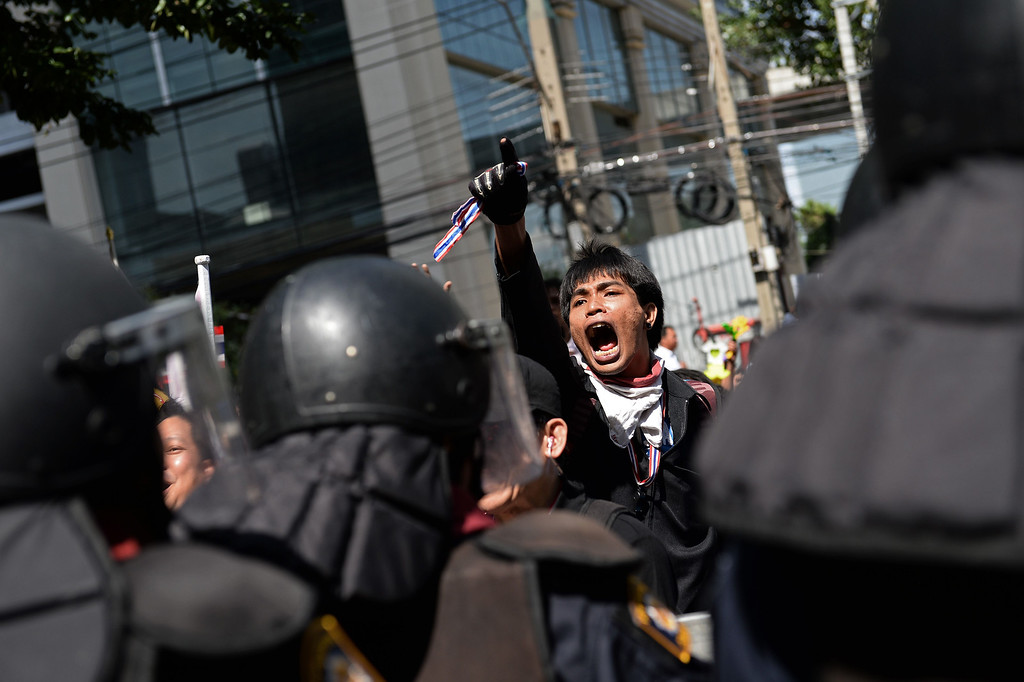 . A Thai opposition protester shouts slogans as protesters face off with police deployed to guard the ruling Puea Thai party headquarters in Bangkok on November 29, 2013.  AFP PHOTO / Christophe ARCHAMBAULT/AFP/Getty Images