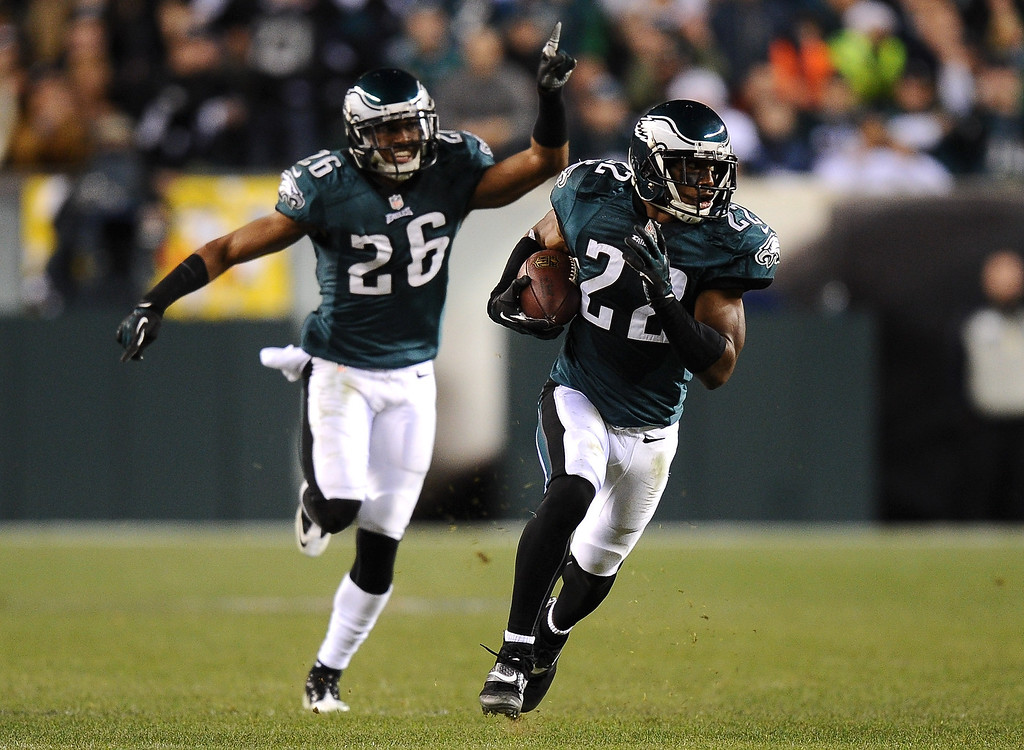 . Brandon Boykin #22 of the Philadelphia Eagles carries the ball downfield for a touchdown after an interception as Cary Williams #26 celebrates behinds him during the fourth quarter against the Chicago Bears at Lincoln Financial Field on Descember 22, 2013 in Philadelphia, Pennsylvania. The Eagles defeat the Bears 54-11. (Photo by Maddie Meyer/Getty Images)