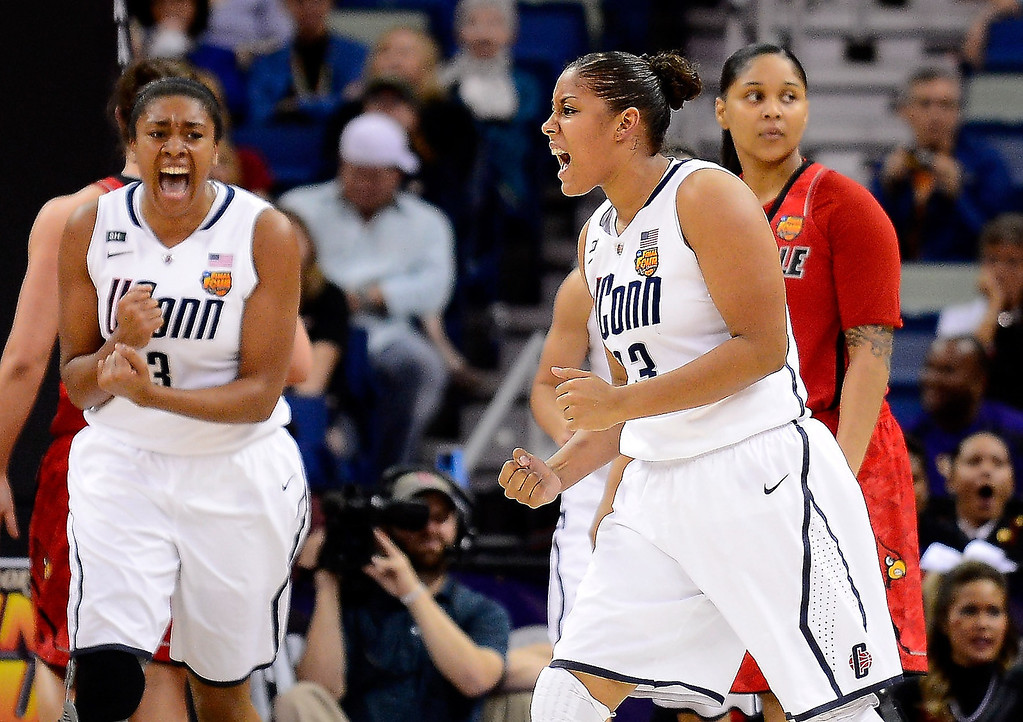 . Morgan Tuck #3 and Kaleena Mosqueda-Lewis #23 of the Connecticut Huskies celebrate after a play in the first half against the Louisville Cardinals during the 2013 NCAA Women\'s Final Four Championship at New Orleans Arena on April 9, 2013 in New Orleans, Louisiana.  (Photo by Stacy Revere/Getty Images)