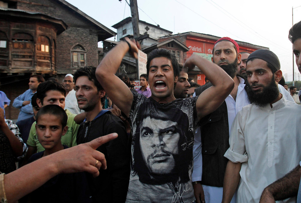 . A Kashmiri man shouts slogans during a protest after paramilitary troops fired on a civilian when he allegedly failed to stop the car he was driving at a police barricade in Srinagar, India, Saturday, Sept. 7, 2013. A protest erupted Saturday after Indian police said they killed two alleged militants and two civilians in the disputed Himalayan territory of Kashmir, while authorities maintained tight security for a classical music concert being staged amid separatist objections. The driver was hospitalized in critical condition. (AP Photo/Mukhtar Khan)