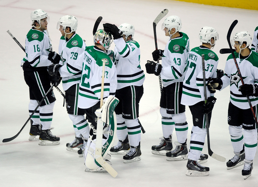 . The Dallas Stars celebrate after defeating the Colorado Avalanche 5-3 at the Pepsi Center Tuesday night, September 24, 2013. Photo By Karl Gehring/The Denver Post