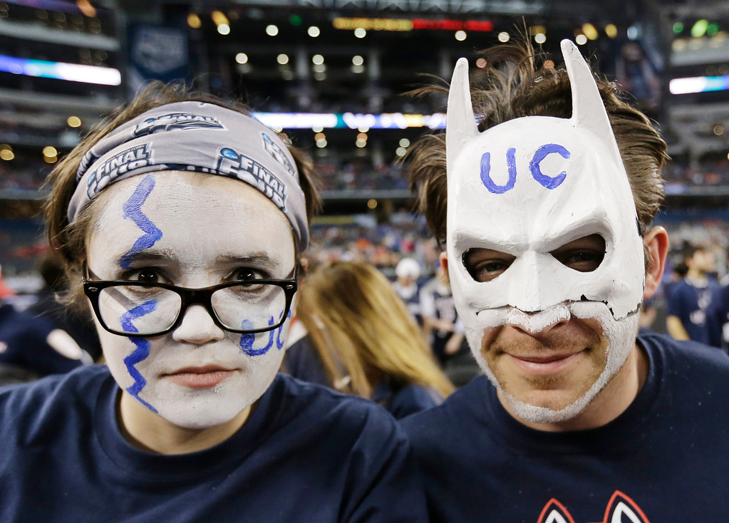 . CORRECTS LOCATION TO ARLINGTON, INSTEAD OF DALLAS - Connecticut fans show their support before Connecticut\'s NCAA Final Four tournament college basketball semifinal game against Florida on Saturday, April 5, 2014, in Arlington, Texas. (AP Photo/Eric Gay)