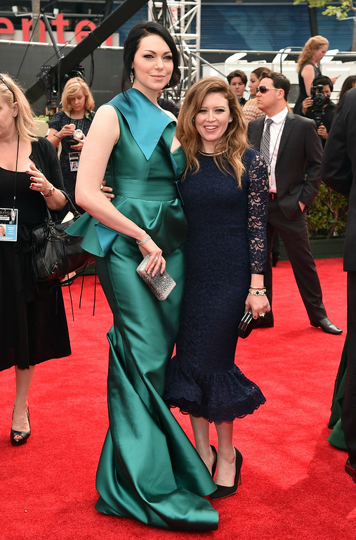 . Actresses Laura Prepon (L) and Natasha Lyonne attend the 66th Annual Primetime Emmy Awards held at the Nokia Theatre L.A. Live on August 25, 2014 in Los Angeles, California.  (Photo by Alberto E. Rodriguez/Getty Images for Variety)