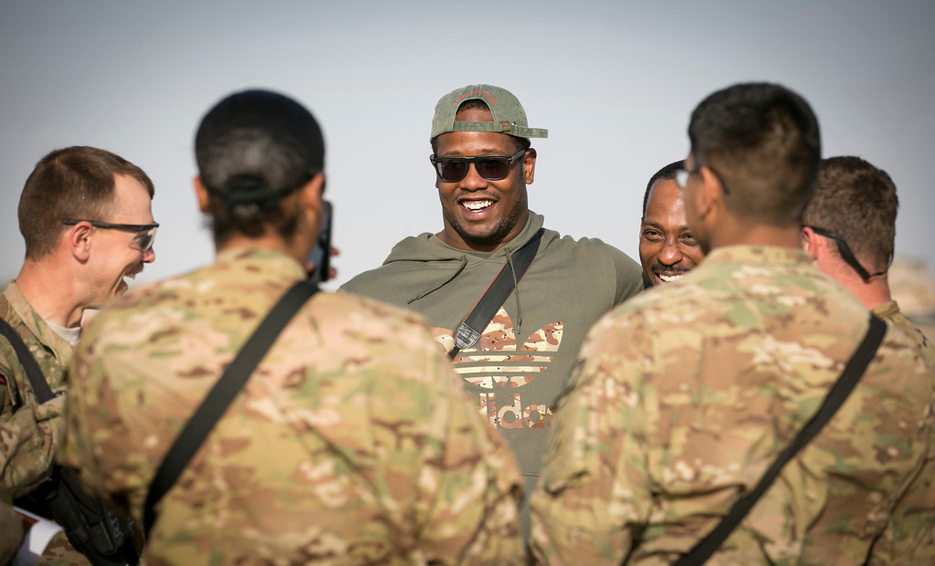 . Denver Broncos linebacker Von Miller visits with troops stationed in the Middle East during a stop on his week-long USO/NFL tour March 17, 2013.   USO Photo by Fred Greaves