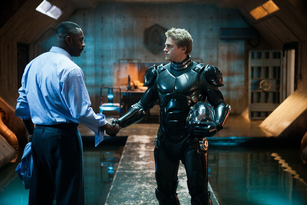 ". (L-r) IDRIS ELBA as Stacker Pentecost and CHARLIE HUNNAM as Raleigh Becket in Warner Bros. Pictures� and Legendary Pictures� sci-fi action adventure ""PACIFIC RIM,\"" a Warner Bros. Pictures release."