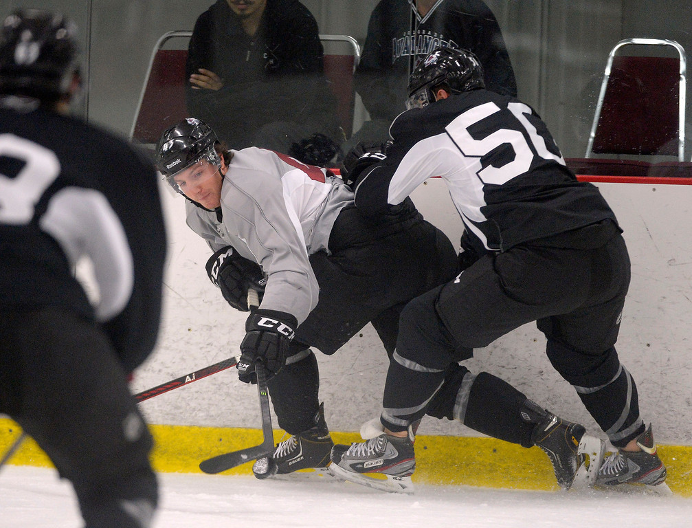 . Colorado Avalanche C Michael Sgarbossa (43) battles for the puck with Colorado Avalanche D Lee Moffie (50) during rookie camp practice September 10, 2013 at Family Sports. The Avalanche will begin its training camp on Sept. 11, with veterans reporting for medical and physical tests. The full squad will be on the ice for three days, Sept. 12-14,.(Photo By John Leyba/The Denver Post) (Photo By John Leyba/The Denver Post)