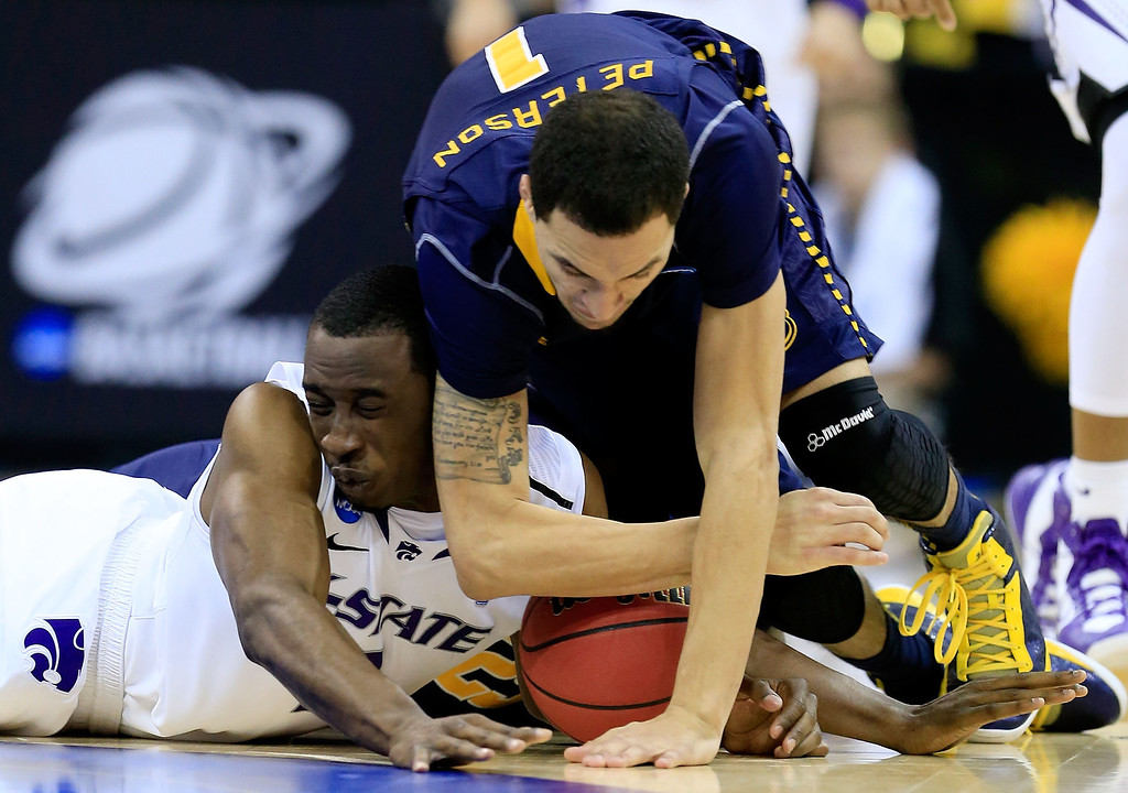 . KANSAS CITY, MO - MARCH 22:  Martavious Irving #3 of the Kansas State Wildcats fights for possession of the ball against D.J. Peterson #1 of the La Salle Explorers in the second half during the second round of the 2013 NCAA Men\'s Basketball Tournament at the Sprint Center on March 22, 2013 in Kansas City, Missouri.  (Photo by Jamie Squire/Getty Images)