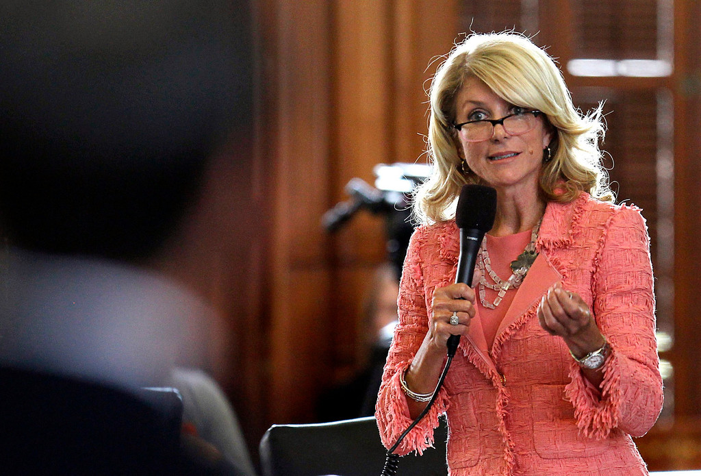 . Texas State Democratic Senator Wendy Davis questions the state\'s Republican Senator Glenn Hegar, sponsor of HB1, as the state Senate meets to consider legislation restricting abortion rights in Austin, Texas July 12, 2013. A Republican proposal that would ban most abortions in Texas after 20 weeks of pregnancy moved toward a possible final vote in the state Senate Friday, and Democrats fiercely opposed to the measure conceded they will not be able to stop it. Davis drew national attention last month by staging a filibuster on the final day of a special session.      REUTERS/Mike Stone