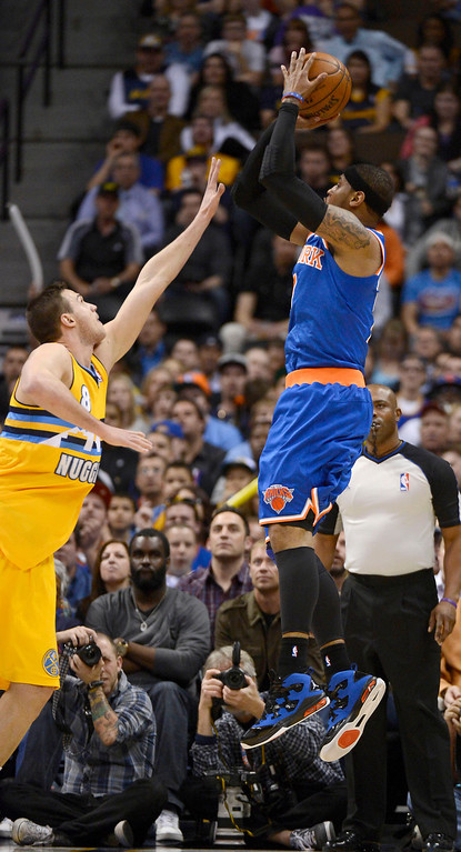 . Carmelo Anthony (7) of the New York Knicks takes a shot over Danilo Gallinari (8) of the Denver Nuggets during the first quarter March 13, 2013 at Pepsi Center. (Photo By John Leyba/The Denver Post)