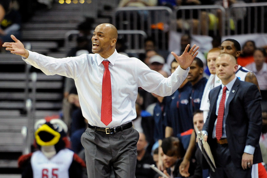 . Metro State coach Derrick Clark yells to the court during the second half of the NCAA Division ll national championship basketball game against Drury, Sunday, April 7, 2013, in Atlanta. Drury won 74-73. (AP Photo/John Amis)