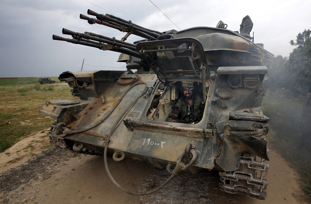 . A Syrian soldier sits inside a tank as troops take control of the village of Western Dumayna, some seven kilometers north of the rebel-held city of Qusayr, on May 13, 2013. Syrian troops captured three villages in the strategic Qusayr area of Homs province, allowing them to cut supply lines to rebels inside Qusayr town, a military officer told AFP. JOSEPH EID/AFP/Getty Images