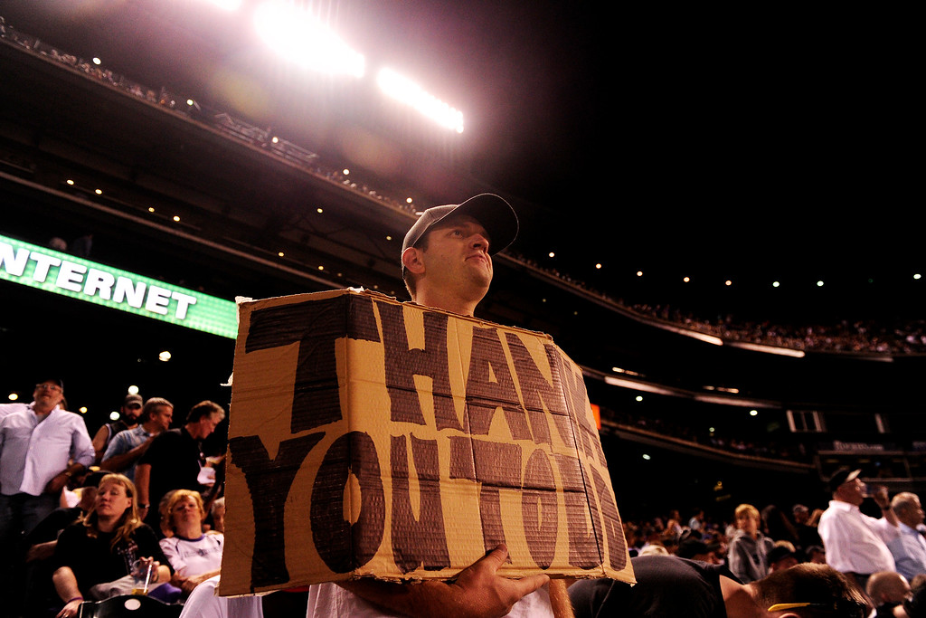 . Nick Heffley holds a sign paying homage to Todd Helton (17) of the Colorado Rockies during the action in Denver. The Colorado Rockies hosted the Boston Red Sox and said farewell to longtime first baseman Todd Helton, who recently announced his retirement following this season. (Photo by AAron Ontiveroz/The Denver Post)
