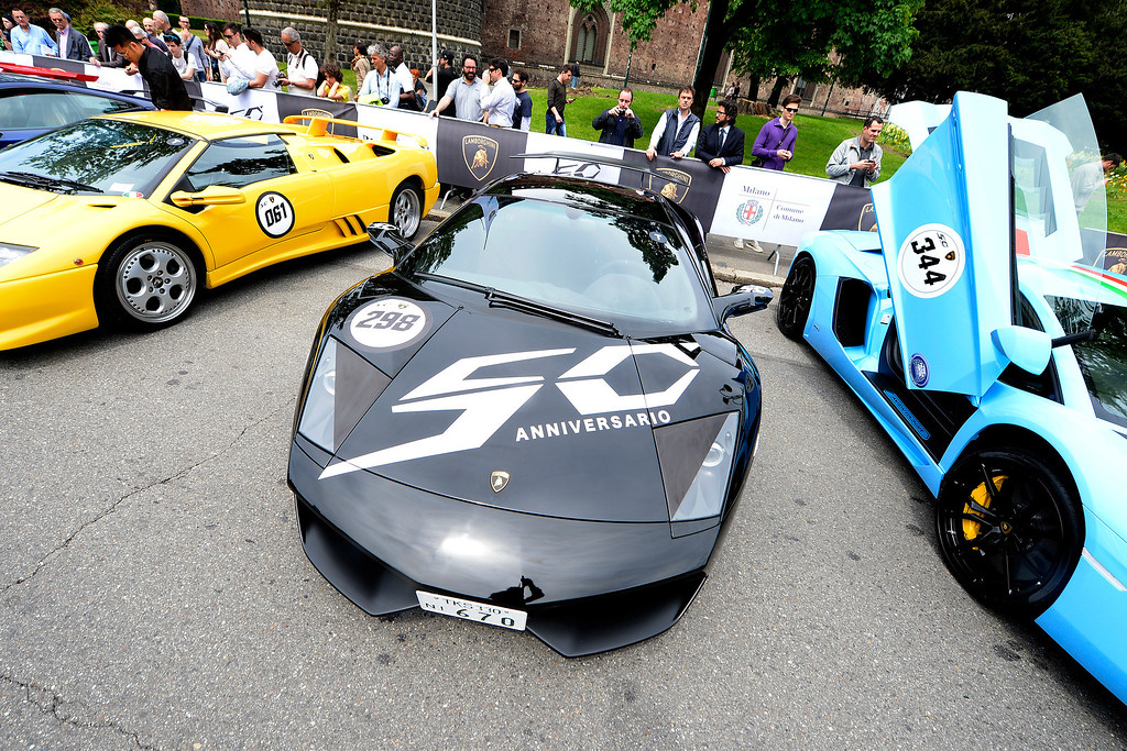 . A Lamborghini sport car with the 50th anniversary logo is parked on May 7, 2013 in front of Milan\'s Sforza castle in Milan on the eve of the first leg of a 1,200km Grand Tour through Italy to mark the 50th anniversary of the carmaker.   OLIVIER MORIN/AFP/Getty Images