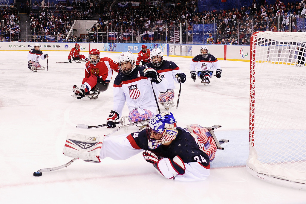 . Goalkeeper Steve Cash of the United States stretches for the puck during the ice sledge hockey gold medal game between the Russian Federation and the United States of America at the Shayba Arena during day eight of the 2014 Paralympic Winter Games on March 15, 2014 in Sochi, Russia.  (Photo by Dennis Grombkowski/Getty Images)