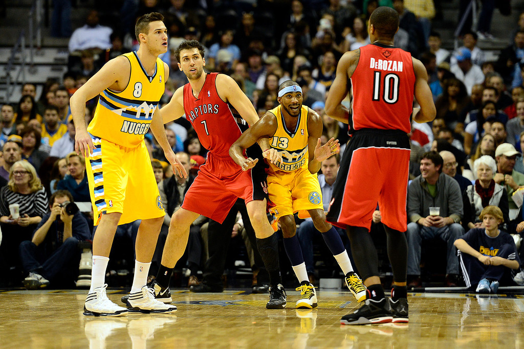 . Denver Nuggets small forward Corey Brewer (13) and Toronto Raptors center Andrea Bargnani (7) jostle for position during the first half at the Pepsi Center on Monday, December 3, 2012. AAron Ontiveroz, The Denver Post