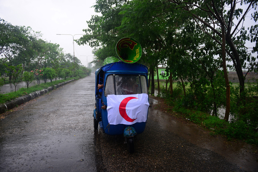 . Bangladeshi Red Crescent Society members announce evacuation orders using loudspeakers on top of an auto-rickshaw as Cyclone Mahasen heads towards landfall in Chittagong on May 15, 2013. Hundreds of thousands of people in Bangladesh and Myanmar were ordered to evacuate Wednesday as a cyclone bore down on coastal areas home to flood-prone refugee camps for victims of sectarian unrest.  MUNIR UZ ZAMAN/AFP/Getty Images