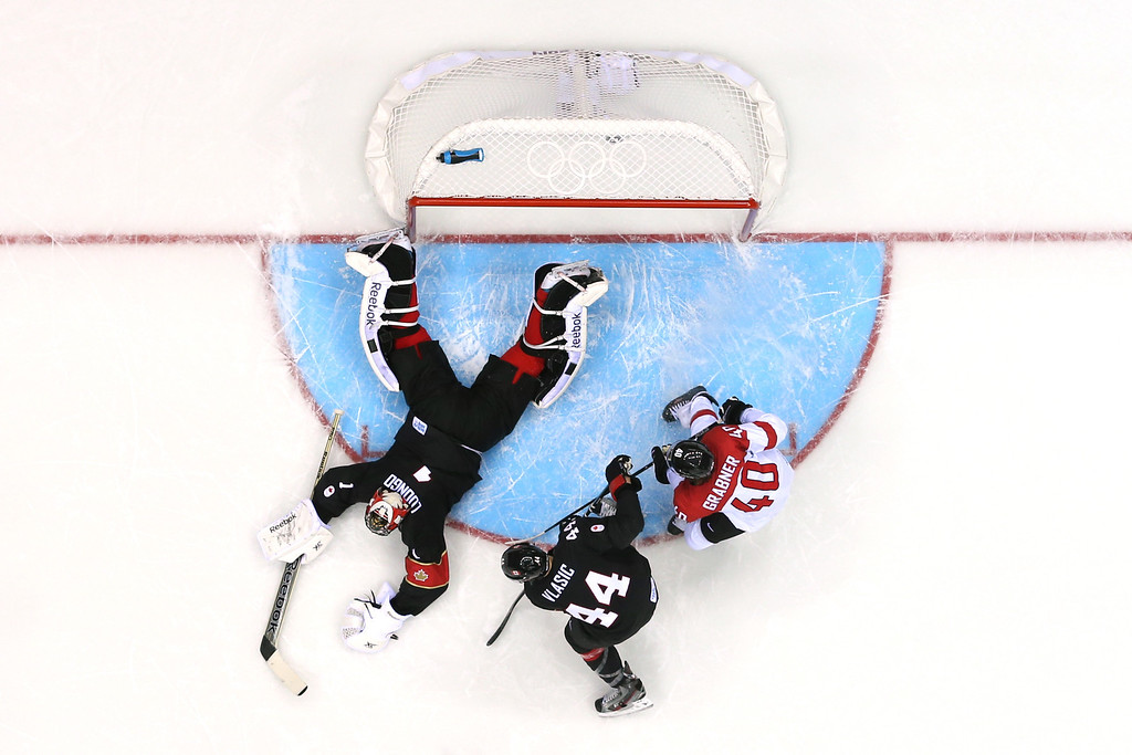 . SOCHI, RUSSIA - FEBRUARY 14:  Roberto Luongo #1 of Canada tends goal against Austria during the Men\'s Ice Hockey Preliminary Round Group B game on day seven of the Sochi 2014 Winter Olympics at Bolshoy Ice Dome on February 14, 2014 in Sochi, Russia.  (Photo by Bruce Bennett/Getty Images)